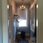 Room 3 Hallway to private bath with towel warmer, mini fridge, 2nd sink