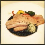 California striped bass with squid ink risotto and Meyer lemon butter