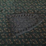 Imprint of steam iron burned into carpet