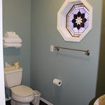 Beautiful stained glass window in the bathroom Room #15