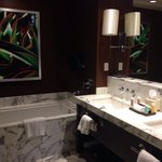 Pretty marble and dark brown bathroom. Separate toilet room, shower and bathtub.