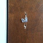 Door to adjoining room...repaired with rubber cement?