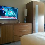 View of the Tv from one of the beds in the queen suite.