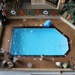Indoor pool view from room balcony