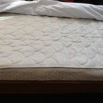 Damaged plus low quality mattress, room 1503