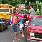 Street scene of the happy Tico soccer fans.
