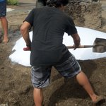 wet sheets, then covered with sand