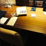 Plain laminated type of wood like desk in one of our rooms.