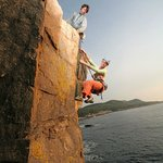 Rock climbing on Otter cliff in Acadia National Park with Acadia Mountain Guides