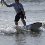 standing up, first time surfing!