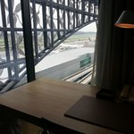 View of runway sitting at the writing desk in the room