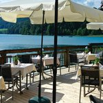 The lakeside terrace all prepared for dining