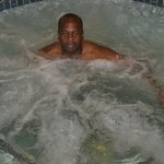 MR. HILL, ENJOYING THE HOT TUB