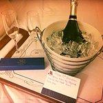 Wishing us a Happy anniversary with Complimentary champagne and chocolates from our new friend,