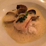 White fish with rice, clam sauce foam, clams, diced chorizo