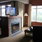 Big roomy family room with fireplace and big screen tv.