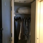 Smallish closet with ironing board & robes