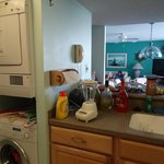 standing in the kitchen (washer/dryer to left) with living room in front