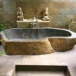 Humongous beautiful stone-carved bathtub in Villa Maia.
