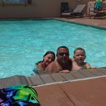 dad and kids at pool