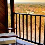 Enjoy a relaxing sundower from your private balcony overlooking game activity at the waterhole