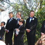 "the handsome groomsmen, ring bearer and ""here comes the bride"" sign boy"