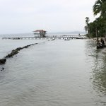 The nearby beach, rocky and very small,