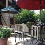 Delightful small patio in back with a little fountain nestled in among the hostas.