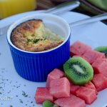Gourmet Breakfast: Egg and sausage souffle with fresh fruit, toast and scones