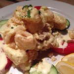Calamari in Buttermilk and fried with Calamata Olives, Roasted Sweet Peppers & served with Lemon