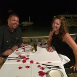 14th anniversary dinner complete with ocean side seating and a table full of rose pedals.