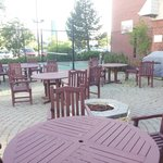 A small Tennis / Basketball court - tables for outside eating, hangingout - there is a firepit t