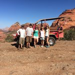 Group shot by the jeep. Amazing scenery.