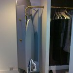 Back of the mirror hiding ironing equipment