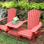 Adirondack chairs on side of house