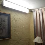 Ciling light fixture mounted on wall