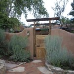 Entrance to a casita and adobe fence for privacy
