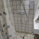A typical well designed Danish shower with cool floor wiper to wipe away the water!