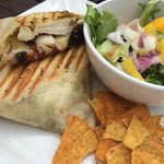 Chicken and Black Pudding wrap served with a side salad and tortilla chips