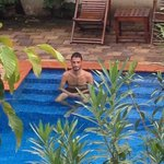 My boyfriend in the swimming pool photos from the balcony of my room !!