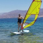 At a  wind-surfing lesson.