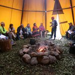 Gathering in our lavvu, sami traditional tent with fire in the middle