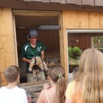 zoo worker talking to the kids about an anteater