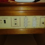 Last century, control panel beside bed.