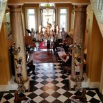 Three piece strings ensemble in Ballyseede Castle foyer.