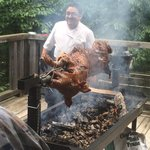 Chef roasting hog