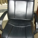 desk chair with battered armrests