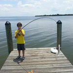Son catches his first fish
