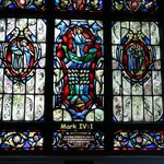 Stained glass illustrates Biblical references to the sea.