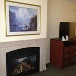 Fireplace and tasteful artwork